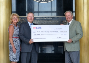 Governor Dalrymple with Tim Hennessy (Regional president of US Bank) and Jolene Kline in the Memorial Hall of the Capitol Building for the presentation of $4,000,000 from US Bank to the ND Housing Incentive Fund.